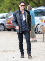 Dave Gardner wearing check shirt, leather jacket, black jeans and sunglasses at Badbury Clump, Oxfordshire