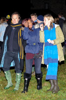 Kate Moss, John Hitchcox and Phoebe Vela looking casual at bonfire party.