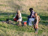 Unknown group of characters on set in field by campfire