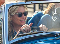 Close up of Kate Moss driving MG sports car with no wedding band