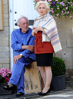 Sir Michael Gambon as wearing blue pyjamas and monogrammed slippers with Hetty Banes-Russell