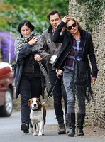 full length walking  towards camera, Jamie Hince with Archie on lead, Kate Moss and friend alongside.