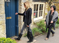 Kate Moss entering pub with friend, carrying Genevieve Jones fringed bag