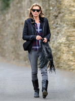 full-lenghth, Kate Moss wearing grey skinny jeans, black boots, Ray-Ban Wayfarer sunglasses, striped 'T', plaid shirt, hoodie with tailored jacket, carrying Genevieve Jones fringed bag