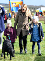 Autumn, Savannah and Isla Phillips with labrador dog