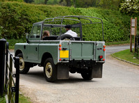 David and Harper Beckham in Land Rover pick-up (back view)