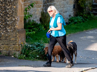 Former Tennis Star and quiz game host Sue Barker walking  her dogs