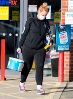 Josie Gibson in black tracksuit and trainers