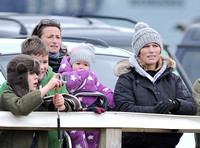 Zara Phillips with daughter held by Dolly Maude wear matching woolly hats