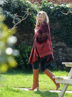 Kate Moss wears patterned blanket wrap at Cotswold pub