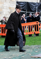 Benedict Cumberbatch as Sherlock, wearing Inverness cape and deerstalker