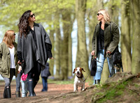 Supermodel Kate Moss wearing military style jacket, skinny jeans and cowboy boots takes a walk with her dog Archie and Liv Tyler who looked cool wearing a poncho teamed with Hunter wellies