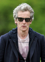 Head shot of Peter Capaldi wearing Ray Ban sunglasses
