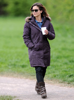 Full length shot of Jenna Coleman on 29th birthday, on set to film Doctor Who, wearing sunglasses and padded purple coat holding polystyrene cup