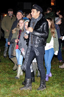 Jamie Hince casual all black look in leather biker jacket, engineer boots, skinny jeans wearing military style hat.