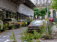 dystopian street scene with rusted out vehicles