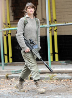 Gemma Arterton in fatigues carrying rifle