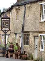 "A street scene in the fictional village of Downton outside the ""Dog and Duck"""