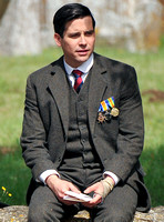 Rob James-Collier sat on cotswold wall