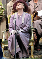 Maggie Smith as Violet Crawley wearing lilac sitting with nose in the air.