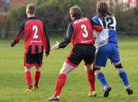 Back shot Stuart 'Psycho' Pearce No. 3 shirt with No 2 player for Longford AFC v Pearce grabbing arm of Wotton Rovers player with long hair wearing black headband
