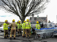 Car flattens bike stand and mounts row of trolleys in accident in Tewkesbury, Gloucestershire
