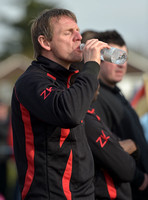 Stuart 'Psycho' Pearce for Longford AFC wearing team tracksuit drinking water from bottle,