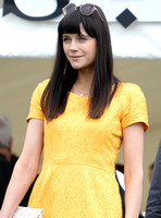 Lilah Parsons wearing bright yellow mini dress