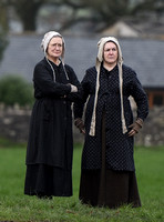 two women in period Jersey dress of the day