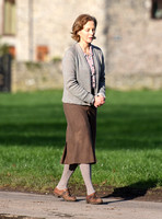 Jenny Seagrove in handcuffs wearing calf length skirt and thick woolly stockings
