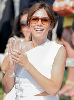 Actress Anna Friel wearing white one shoulder dress, sunglasses