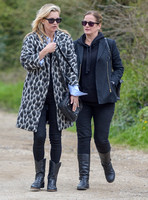 Kate Moss wearing Gucci mohair animal print overcoat with one other female
