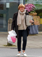 TV presenter Anne Robinson carrying ice buckets