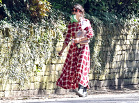 Amelia Warner wearing red and white check dress