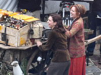 "Lily James and Katherine Parkinson filming a scene for WWII drama  ""Guernsey"" at Clovelly Harbour"