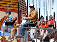 Jamie Oliver and Buddy Bear Maurice on fairground ride at Big Feastival