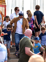Jamie Oliver with Petal Blossom Rainbow and Buddy Bear Maurice on fairground ride at Big Feastival