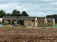 exterior building views of Beckham's triple barn conversion