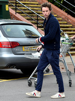 Eddie Redmayne wearing blue cardigan, skinny jeans and trainers on shopping trip to Stroud