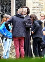 Aidan Turner and crew members in front of Chavenage House