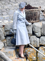 "Lily James filming scenes from ""Guernsey"" at Clovelly Harbour"