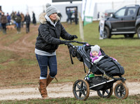Zara Phillips with Daughter in buggy wearing matching woolly hats
