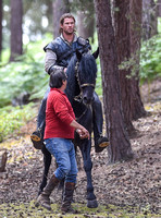 Chris Hemsworth on horseback with horse master alongside