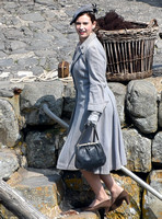 "Lily James filming scenes for upcoming WWII movie ""Guernsey"" in Clovelly Harbour, North Devon, United Kingdom  - 5th May, 2017"