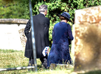 back view of Penelope WSilton and Douglas Reith in churchyard.