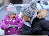 Zara Phillips with Daughter both laughing and wearing matching woolly hats