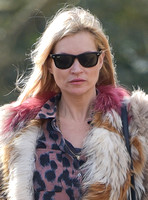 Kate Moss wearing Isabel Marant fur jacket and suede ankle boots with her dog Archie