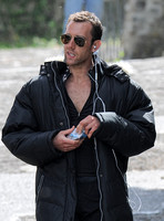 Close up of Matthew Lewis wearing sunglasses and earphones