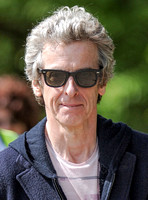 Tight head shot of Peter Capaldi wearing Ray Ban sunglasses